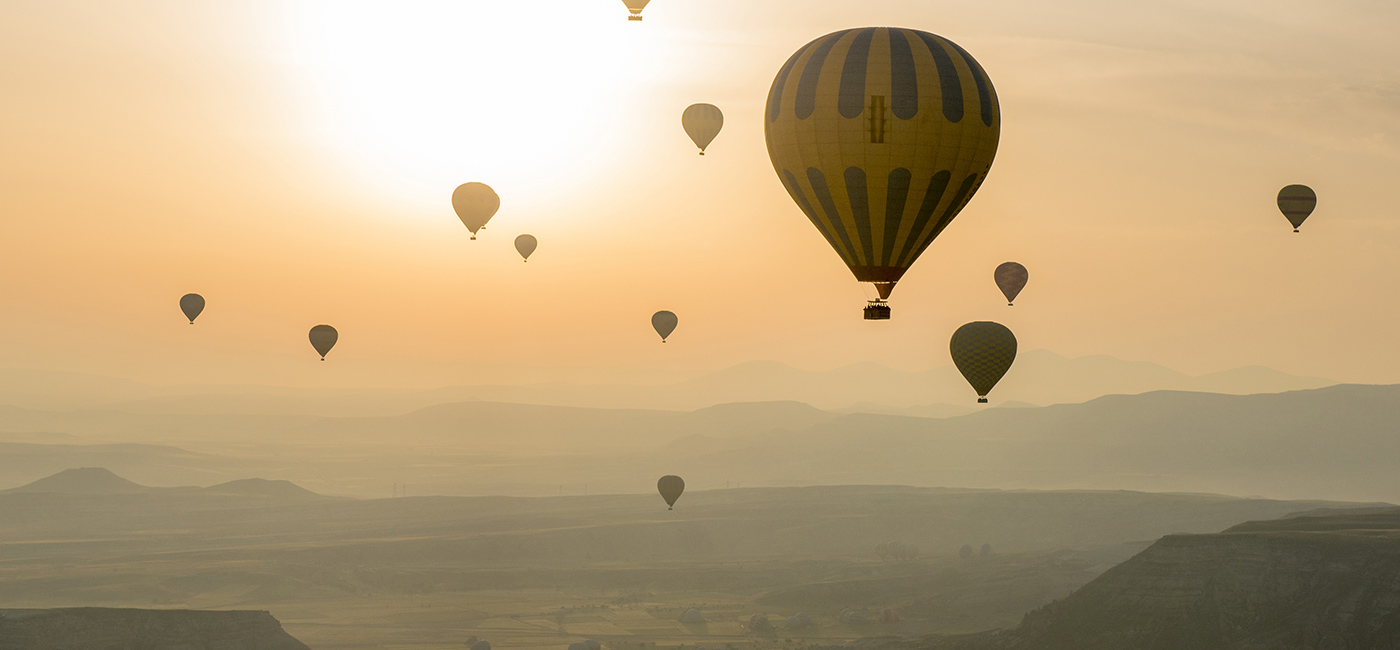 [Header] [About us] [International Development] Hot-air balloons at sunset